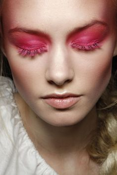 Vivienne Westwood ss 12 backstage beauty. Beautiful pink eyeshadow extending the the eyelashes.