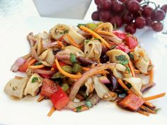 A refreshing salad using squid.there's more than one way to eat your calamari. Nutrition Plans, Healthy Nutrition, Calamari, Eat Right, Serving Size, Pasta Salad, Great Recipes, Salad Recipes, Stuffed Peppers