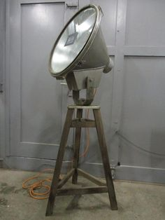 Vintage stadiumlight mounted on a wooden tripod. DM for pricing
