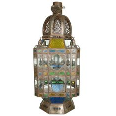 For Sale on - Extra large Moroccan candle glass lantern from Marrakesh, clear and multicolored glass adorned with filigree Moorish designs. Clear glass bottom, one door Garden Candle Lanterns, Floor Lanterns, Modern Lanterns, Antique Lanterns, Moroccan Lanterns, Moroccan Tiles, Moroccan Decor, Candle Lamp, Glass Candle