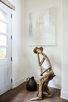 Escultura de Don Quijote hecha con madera