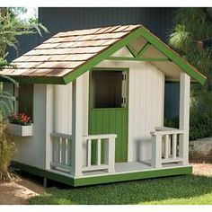 Build an Outdoor Playhouse for Your Children.  Plan to build one on a redwood stump.