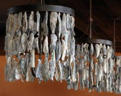 Hunter Mcrae-Oyster shell chandeliers hang from the ceiling of the Rocks on the Roof lounge at The Bohemian Hotel Savannah Riverfront, which opens today.  Hunter McRae/Savannah Morning News