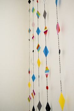 Some twine and cut out colorful magazine or paper into diamonds.