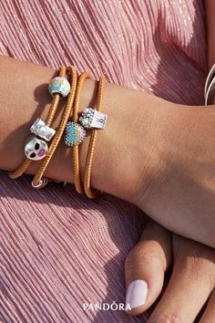 Love is all around when you wear these vibrant new charms, from sparkling hearts to sweet treats and emoticon-inspired designs. Crafted in sterling silver and embellished with colourful stones, crystal pearls and enamel, these must-haves have a place in every heart and jewellery box.