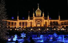 Tivoli Gardens in Copenhagen, Denmark. We were there for just 22 hours, but we went into the Tivoli for a little while and it was so beautiful. It was all decorated with Christmas lights and there were tons of vendors and rides. It really was like going to an older version of Disney (Disney based his theme park design on Tivoli.). We had a great time in November 2011 while there.