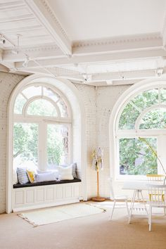 Arched windows with window seat.