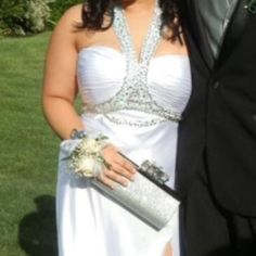 """Prom dress with faux crystals. Dress in excellent condition. Model is 5""""7 with heels and wears large Dresses"""