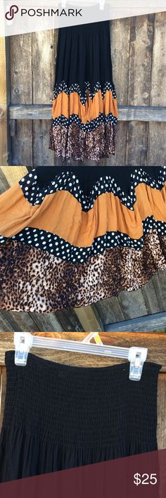 """Strapless dress/ skirt Strapless dress that can be worn as a skirt. Sooo cute!! Pretty polkadot, leopard detail. Flowy and comfy!!! Has an elastic stretchy top. Top measurement across top laying flat is 12"""" unstretched. And length is 34"""". Any questions?? Please ask. I'm open to offers and I ship Same day! Size listed as """"free size"""" 65% cotton and 35% polyester venice blue Skirts"""