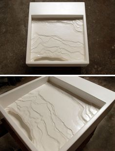 11 Creative Concrete Countertop Designs To Inspire You   This sink resembles an eroding shoreline that tilts down and sends water into a cave-like structure that then sends it down the hidden drain.
