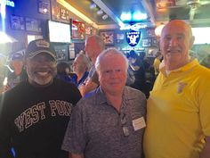 Fraternizing with the Naval Academy and Air Force Academy Alumni as they watch the Navy - Air Force football game...
