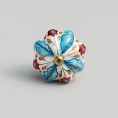 http://www.worldmarket.com/product/blue-and-red-floral-ceramic-knobs-set-of-2.do?