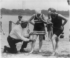 These days, you can get away with wearing practically anything at the beach, but back in the '20s, it was common for inspectors to roam the beaches ensuring women's swimwear wasn't too short—in many cases, rising no more than six inches above the knee. Here are two suspicious girls having their suit lengths checked in 1922, as captured by the National Photo Company.