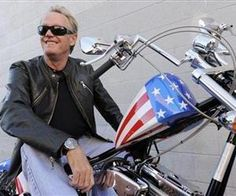 Peter Fonda, who played Captain America in the 1969 film Easy Rider, poses atop a Harley-Davidson motorcycle based on the one he rode in the film, Friday, Oct. 23, 2009, in Glendale, Calif.
