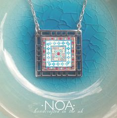 NOA Jewellery stainless steel & decorated walnut small square pendant. ('17 ST316 #14) www.noajewellery.com