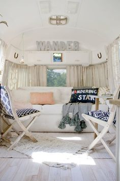 """Like many other outdoor enthusiasts, Sarah Schneider chose an old Airstream trailer to be her family's """"home away from home."""" While the design was kept classic, the renovations are what gave it heart! Airstream Remodel, Airstream Renovation, Airstream Interior, Trailer Remodel, Small Camper Interior, Airstream Decor, Airstream Camping, Bus Interior, Trailer Interior"""
