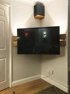 Wall mounted corner TV Stand. DIY. Left over floor boards.