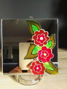 Bloemen op een spiegel