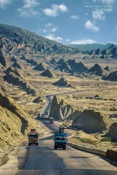 Baluchistan, Pakistan, looks like a plunging syncline (plunging back into the valley from the hills on the horizon).