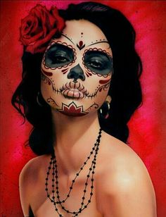 "this is a mexican ""dia de los muertos"" (day of the dead) painted woman she has the traditional paint from many years of Mexican history and it is still used today at the festival ""Dia de los muertos"" (day of the dead)."