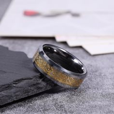 The silver tungsten carbide wedding ring with gold plated celtic dragon inlay has high polished finish, beveled edge, classic design, which will never out of date. The unisex tungsten wedding band is the best gift for wedding. Matching Wedding Bands, Wedding Ring Bands, Celtic Dragon, Celtic Art, Mens Ring Designs, Mom Ring, Tungsten Carbide Wedding Bands, Celtic Rings, Best Wedding Gifts