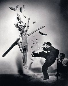 In 1941, American photographer Philippe Halsman met the surrealist artist Salvador Dalí in New York City and they began to collaborate in the late 1940s. The 1948 work Dali Atomicus explores the idea of suspension, depicting three cats flying, water thrown from a bucket, an easel, a footstool and Salvador Dalí all seemingly suspended in mid-air.