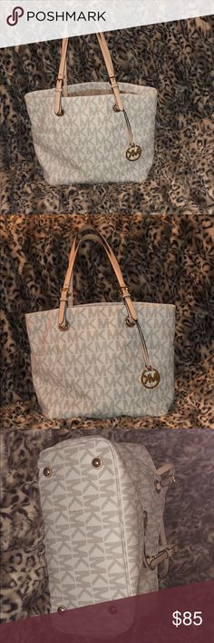 Michael Kors Jet Set Tote Michael Kors Jet Set Tote in perfect condition. Purchased this MK along with the black Coach that's in my closet here on Posh. After doing so. I came across my dream purse. So I'm letting these go so I can buy it. Michael Kors Bags Totes