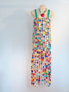 Dress and neckpiece fashioned from Tupperware lids and 2000 jumprings.