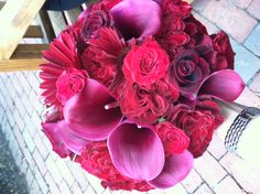 Fun sample for a November bride!  Burgundy roses, Cranberry Calla, Garnet Gerbera!