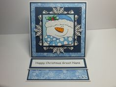 (Ref:F14) 15cm x 15cm easel card. Main image from a Woodware stamp coloured with Promarkers. Background papers 'Nitwit' download. Sue Wilson corner snowflake die used behind snowman.