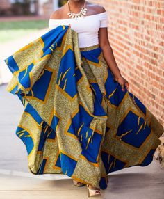 Maxi skirt made from print fabric with a high waist and is cut on a circle It fastens with a zip at the back and is made from 100% African print