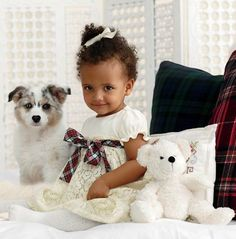 First Holiday: In classic tartan and sweet prints find holiday dresses as darling as she is.