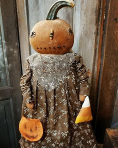 dolls for girls age 3 Click above VISIT link for more - Caring For Your Collectable Dolls. Primitive Pumpkin, Primitive Crafts, Primitive Christmas, Country Primitive, Halloween Displays, Halloween Ornaments, Halloween Pumpkins, Halloween Doll, Fall Halloween