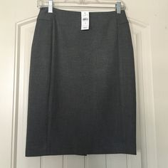 LOFT gray pencil skirt NWT Great stretchy pencil skirt in a pretty gray that goes with everything! Brand new with tags. Never worn. Zipper back and slit. LOFT Skirts Pencil