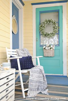 Blue Accents on Yellow Farmhouse Porch