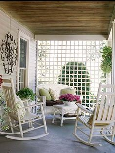 Not crazy about this particular trellis pattern but I am SO doing this to my front porch!  Thinking honeysuckle vines?  Do love Wisteria though...Trellis at end of porch for shade & privacy - with wisteria vines growing on it