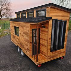 A beautiful tiny house on wheels, named Blue Moon. The home is designed and built of Mitchcraft Tiny Homes of Fort Collins, Colorado.