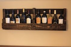 Re-finished pallet wine shelf. Pretty neat.  Heard that wine should be on side.  But use this in pantry for oils and other bottle stuff.