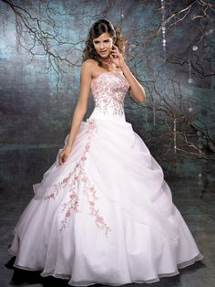 Fascinating and beautiful wedding dress with a touch of peach embroidery