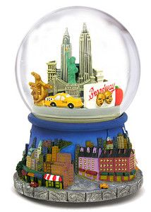 """- EXCLUSIVE -  New York City Revolving   Snow Globes - Gold Series  As Seen on TV!  On Sale NOW!  Best Deal EVER on Our Most Popular Snow Globe!  LIMITED QUANTITIES AVAILABLE  Elegant, sophisticated and unique. Our NEW Collector's Snow Globe features a unique view of New York City's world famous landmarks!  Plays """"New York, New York"""".  6.5"""" Tall.  $39.99 and FREE SHIPPING!"""