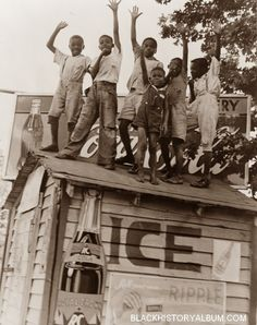 On Top of the World!   1938  A group of African American boys clowning around on top of a refreshment/grocery stand., 1938. Noted advertisements: Cocoa Cola, RC Crown Cola, Ripple roll your own cigarettes.   Courtesy Vintage African American photography courtesy of Black History Album, The Way We Were.On Top of the World!   1938
