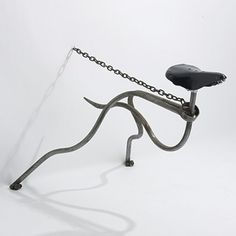"Mark Lewis |  ""Greyhound Chair""  . United Kingdom, c. 1985.  Tubular steel, steel chain, bicycle seat.    40 w x 28 d x 28 h inches"