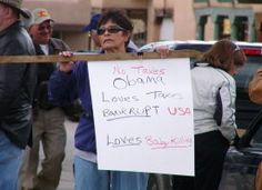 """One stream-of-thought poster reads, """"No Taxes. Obama Loves Taxes. Bankrupt USA. Loves Baby Killing""""--photo by Mary Wood."""