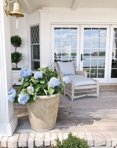 Coastal New England Style in a Minnesota Lake House – Blue and White Home, pack decor decor with dinner bell, outdoor patio with outdoor seating area Outdoor Rooms, Outdoor Living, Outdoor Furniture Sets, Outdoor Decor, Wooden Furniture, Outdoor Seating, Antique Furniture, Back Patio, Backyard Patio