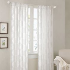Freshen up your living space with this elegant damask curtain panel. This sheer 84-inch curtain panel features a trendy golden chocolate damask print over a white linen background. Or, for a more traditional look, opt for the solid white panel.