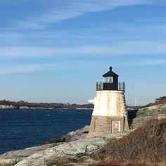 Castle Hill Light, located on Narragansett Bay in Newport, Rhode Island at the end of historic Ocean Drive. Showcasing my love for RI, I have listed the RI state flag Wreath. Do I have any fans from Lil Rhody? Use code MUCHTHANKS to save 10% (exp . 1/31).  For more Beach Theme Wreaths check out : https://www.etsy.com/shop/WreathObsessed?section_id=19541957