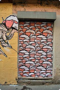 Sheepest Street Art roll-up door in La Crois- Rousse, Lyon, Auvergne-Rhône-Alpes, France.
