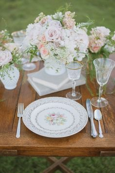 So romantic! Place setting for an outdoor farmhouse themed wedding reception #wedding #tablescapes #placesetting #farmhousewedding #vintage