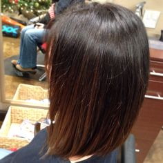 Balayage Carmel highlights on dark brown hair. Aveda color.
