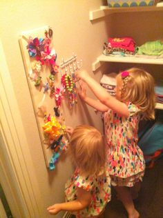 Start them organizing early! Barrette holder and some hooks for their jewelry.